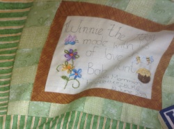 Hot off the needle - Winnie the Pooh quilt label