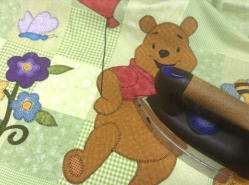 Hot off the needle - Winnie the Pooh quilt ironning
