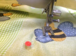 Hot off the needle - Winnie the Pooh quilt machine applique