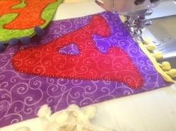 Sewing pompom braid to flag