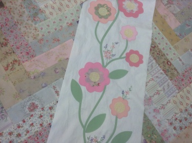 Friendship braid quilt - hand embodied flower sprigs