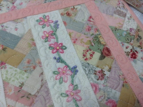 Miniature friendship braid quilt with hand embroidery