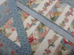 Sewing the binding on.