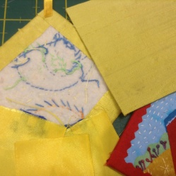 "Glued ribbon to the back of the rosette on right, background fabric glued onto 4"" cardboard"