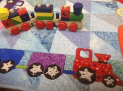 """""""quilts, bibs, blankies ... oh my!"""" by Kim Schaefer quilt """"cars, buses, trucks and trains quilt"""""""
