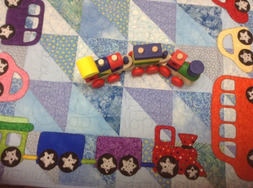 """quilts, bibs, blankies ... oh my!"" by Kim Schaefer quilt ""cars, buses, trucks and trains quilt"""