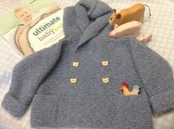 "Hoody jacket knitted with Sidar Denim Sport Aran using a pattern from ""The Ultimate book of Baby Knits"" by Debbie Bliss."