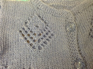 "The pattern is out of ""Heirloom Baby Knits"" by Deborah Newton, the one I knitted is Pumpkin Pie – Lacy Cardigan Jumper on pg 66"
