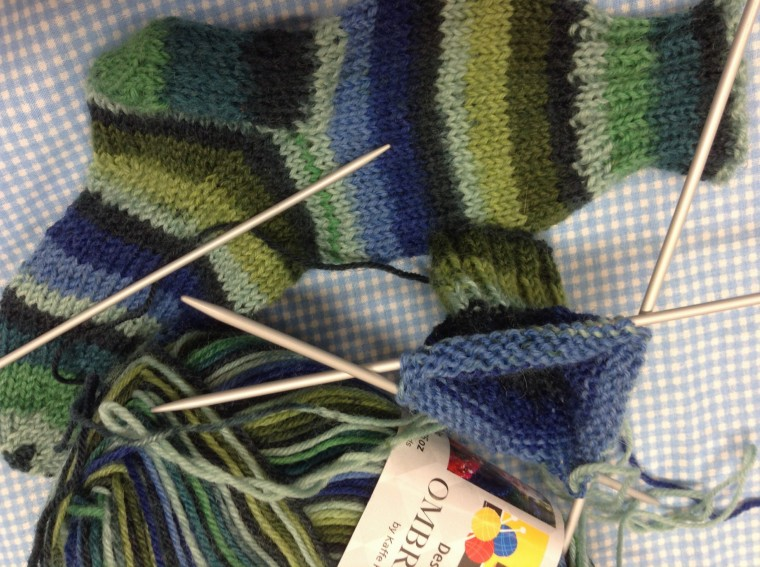Buzy knitting socks for a 2 year old little man.